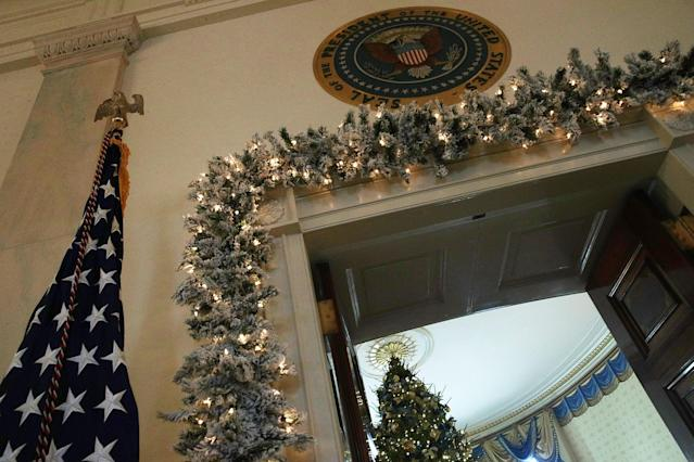 "<p>The official White House Christmas tree stands in the Blue Room at the White House during a press preview of the 2017 holiday decorations November 27, 2017 in Washington, DC. The theme of the White House holiday decorations this year is ""Time-Honored Traditions."" (Photo: Alex Wong/Getty Images) </p>"