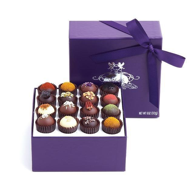 """<h2>Vosges Exoctic Truffle Collection </h2><br>Don't think of a box of chocolates as low-hanging fruit — it's an opportunity to really splurge on the finest version of what everyone really loves. (Candy.)<br><br><strong>Vosges Chocolate</strong> Exotic Truffle Collection (16 Piece), $, available at <a href=""""https://go.skimresources.com/?id=30283X879131&url=https%3A%2F%2Fwww.vosgeschocolate.com%2Fcollections%2Fgifts-25-75%2Fproducts%2Fexotic-truffle-collection-16-pieces"""" rel=""""nofollow noopener"""" target=""""_blank"""" data-ylk=""""slk:Vosges Chocolate"""" class=""""link rapid-noclick-resp"""">Vosges Chocolate</a>"""