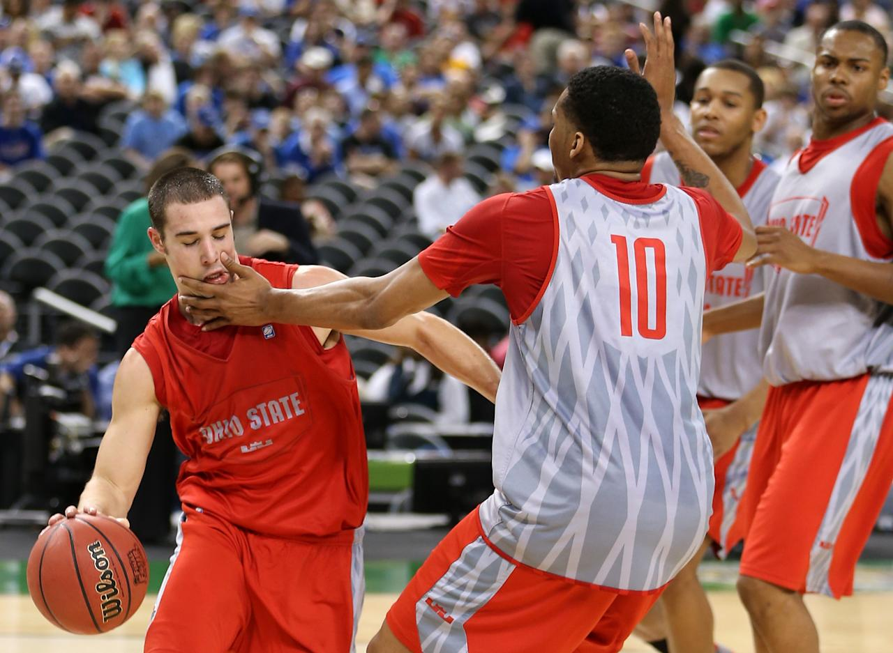 NEW ORLEANS, LA - MARCH 30:  Aaron Craft #4 drives on LaQuinton Ross #10 of the Ohio State Buckeyes during practice prior to the 2012 Final Four of the NCAA Division I Men's Basketball Tournament at the Mercedes-Benz Superdome on March 30, 2012 in New Orleans, Louisiana.  (Photo by Jeff Gross/Getty Images)