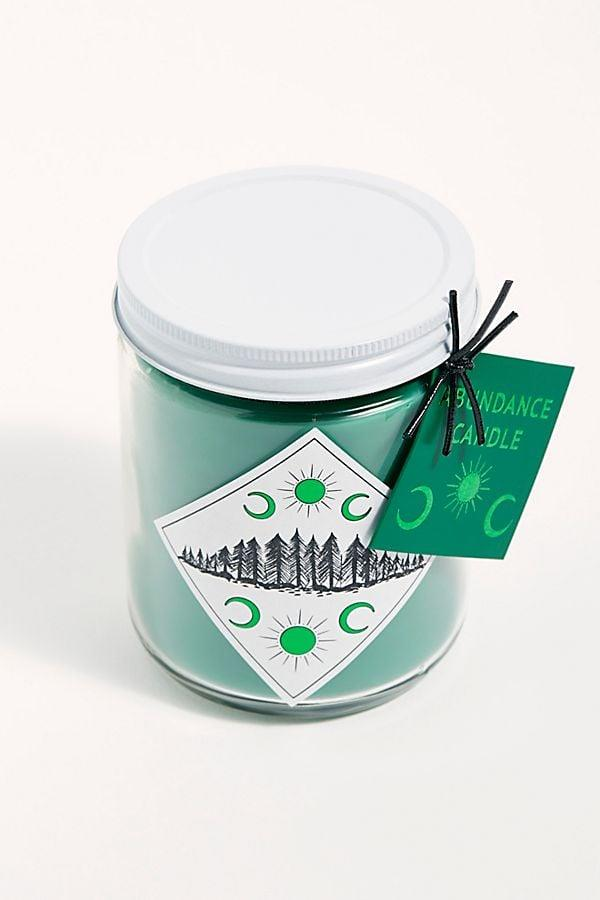 """<p>This <a href=""""https://www.popsugar.com/buy/Spitfire-Girl-Ritual-Candle-482330?p_name=Spitfire%20Girl%20Ritual%20Candle&retailer=freepeople.com&pid=482330&price=35&evar1=casa%3Aus&evar9=46520612&evar98=https%3A%2F%2Fwww.popsugar.com%2Fphoto-gallery%2F46520612%2Fimage%2F46520647%2FSpitfire-Girl-Ritual-Candle&list1=shopping%2Ccandles%2C50%20under%20%2450%2Caffordable%20shopping&prop13=api&pdata=1"""" rel=""""nofollow"""" data-shoppable-link=""""1"""" target=""""_blank"""" class=""""ga-track"""" data-ga-category=""""Related"""" data-ga-label=""""https://www.freepeople.com/shop/spitfire-girl-ritual-candle/?category=SEARCHRESULTS&amp;color=002"""" data-ga-action=""""In-Line Links"""">Spitfire Girl Ritual Candle</a> ($35) makes a great gift.</p>"""