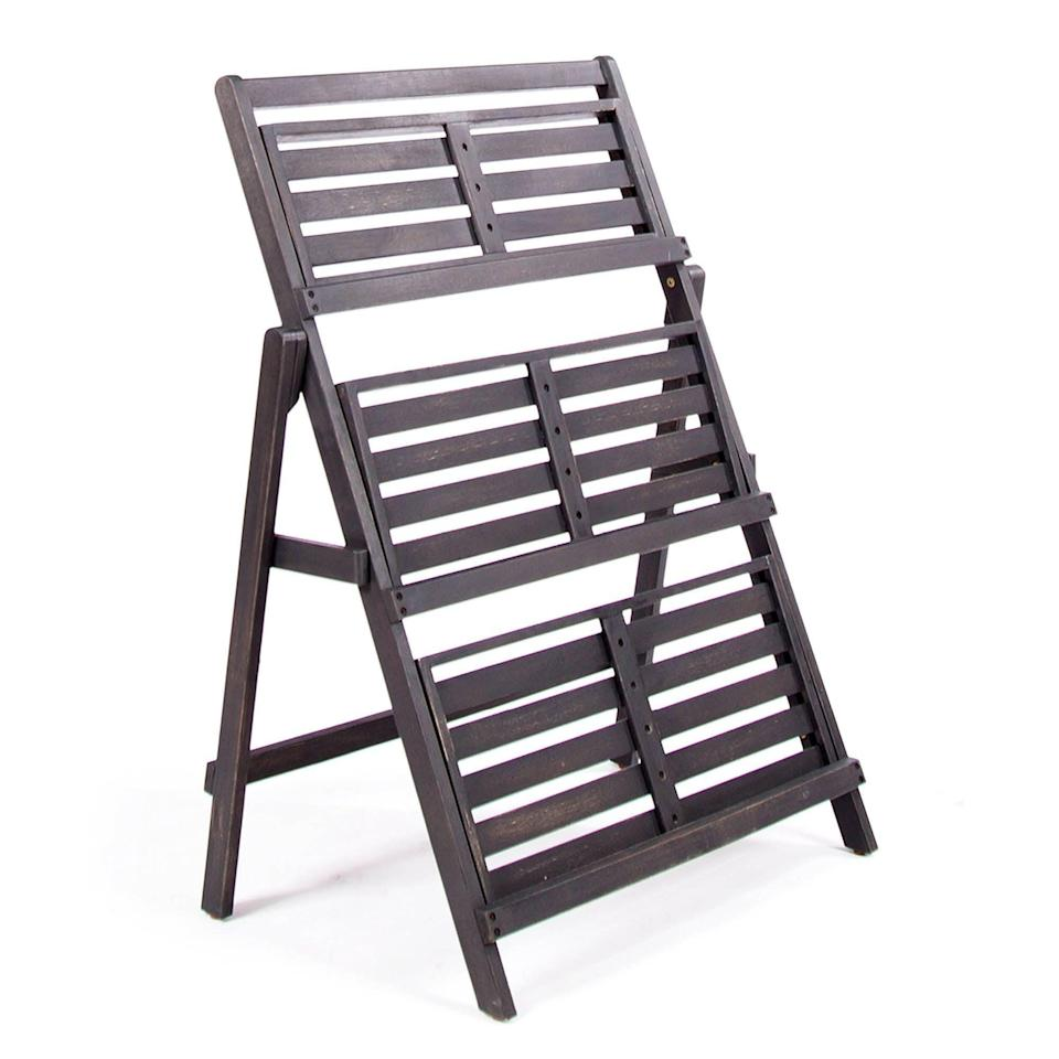 """<p><strong> Charlton Home</strong></p><p>wayfair.com</p><p><strong>$89.99</strong></p><p><a href=""""https://go.redirectingat.com?id=74968X1596630&url=https%3A%2F%2Fwww.wayfair.com%2Ffurniture%2Fpdp%2Fcharlton-home-fenimore-rectangular-multi-tiered-plant-stand-chrl8182.html&sref=https%3A%2F%2Fwww.popularmechanics.com%2Fhome%2Fg36421088%2Fbest-plant-stands%2F"""" rel=""""nofollow noopener"""" target=""""_blank"""" data-ylk=""""slk:Shop Now"""" class=""""link rapid-noclick-resp"""">Shop Now</a></p><p>This solid acacia wood plant stand has a cozy farmhouse style but also works well paired with contemporary decor. It's finished in dark charcoal gray (it appears more brown in photos) and folds up flat for storage. </p><p>It's made for indoor-outdoor use and stands roughly 3 feet high, with three wide, slatted shelves that have raised edges. You can load them up with plants, too, as the stand has a maximum weight capacity of 150 pounds. Customers give it high marks, with an average 4.8 stars from more than 300 reviewers. </p>"""