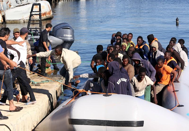 The Libyan coastguard pull a boat carrying African migrants, rescued as they were trying to reach Europe, at a naval base near the capital Tripoli on September 29, 2015 (AFP Photo/Mahmud Turkia)