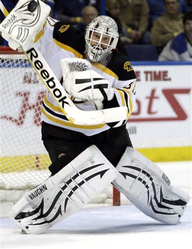 Boston Bruins goalie Tim Thomas (30) makes a blocker save in the second period of an NHL hockey game against the St. Louis Blues, Wednesday, Feb. 22, 2012 in St. Louis. (AP Photo/Tom Gannam)