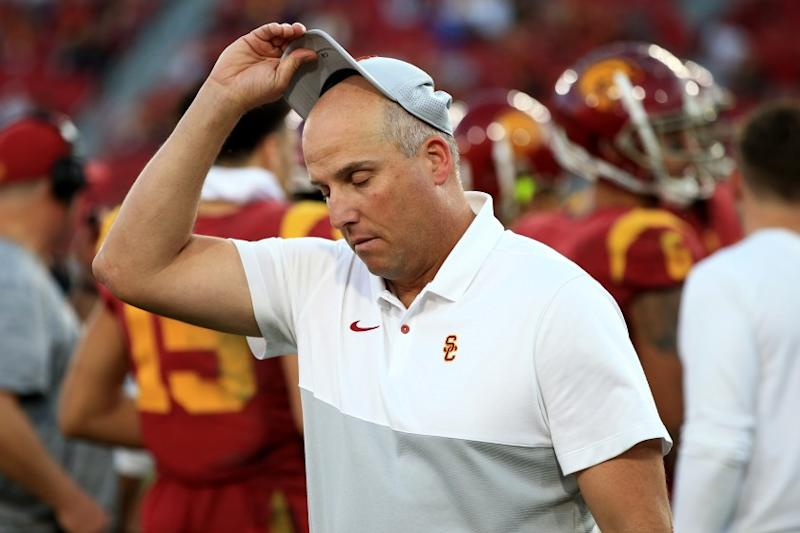 USC coach Clay Helton removes his cap after the Trojans defeated UCLA on Nov. 23 at the Coliseum.