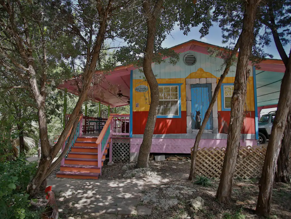 """<h2>Austin, Texas</h2><br><strong>Location:</strong> Cardinal Hills Estates, TX<br><strong>Sleeps:</strong> 6<br><strong>Price Per Night:</strong> <a href=""""https://airbnb.pvxt.net/JrkEgq"""" rel=""""nofollow noopener"""" target=""""_blank"""" data-ylk=""""slk:$255"""" class=""""link rapid-noclick-resp"""">$255</a><br><br><em>Ed. note: Not 100% a cabin, but we couldn't NOT include this colorful fun house.</em><br><br>""""...This colorful place is like being transported to an interior Mexican hacienda with folk art decor, Guatemalan textiles from the owner's travels, and a private art collection. Artistic murals, palm trees, and lighting add to the colorful, artsy atmosphere. Walking trails wander through the hillside and provide a nice place to walk your well-mannered pet (pre-approval and pet fee required).""""<br><br><h3>Book <a href=""""https://airbnb.pvxt.net/JrkEgq"""" rel=""""nofollow noopener"""" target=""""_blank"""" data-ylk=""""slk:Lemon, Lime, & Coconut Mexican Style Bungalow"""" class=""""link rapid-noclick-resp"""">Lemon, Lime, & Coconut Mexican Style Bungalow</a><br></h3>"""
