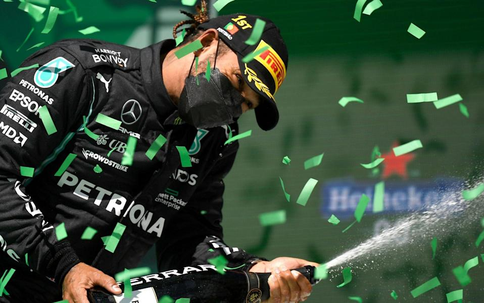 British Formula One driver Lewis Hamilton of Mercedes-AMG Petronas celebrates on the podium after winning the Formula One Grand Prix of Portugal at the Autodromo Internacional do Algarve near Portimao, Portugal, 02 May 2021 - Gabriel Bouys/POOL/EPA-EFE/Shutterstock