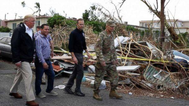 FEMA administrator Brock Long, second from right, with President Donald Trump and Lt. Gen. Jeff Buchanan, right as they toured an area affected by Hurricane Maria in Guaynabo, Puerto Rico, Oct. 3, 2017. (AP)