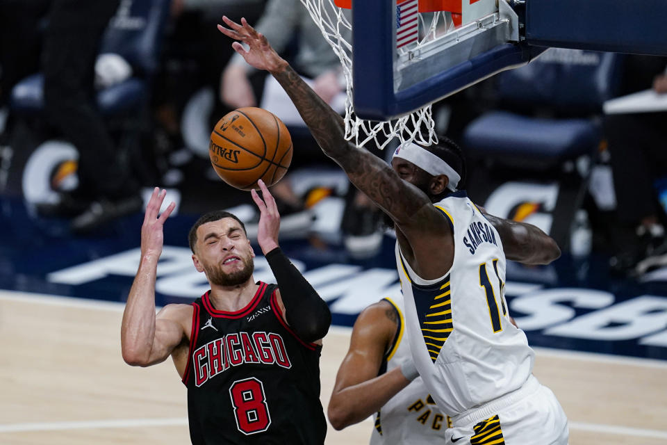 Indiana Pacers forward JaKarr Sampson (14) stops the shot of Chicago Bulls guard Zach LaVine (8) during the second half of an NBA basketball game in Indianapolis, Tuesday, April 6, 2021. The Bulls won 113-97. (AP Photo/Michael Conroy)