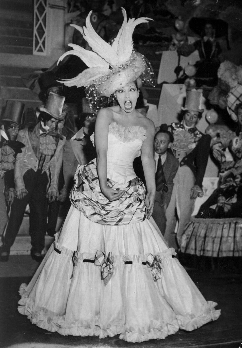 FILE - In this Feb. 21, 1949 file photo, singer and dancer Josephine Baker performs during a show in Paris. The remains of American-born singer and dancer Josephine Baker will be reinterred at the Pantheon monument in Paris, making the entertainer who is a World War II hero in France the first Black woman to get the country's highest honor. Le Parisien newspaper reported Sunday Aug. 22, 2021, that French President Emmanuel Macron decided to organize a ceremony on November 30 at the Paris monument. (AP Photo/File)