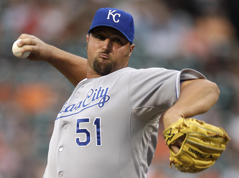 FILE - In this May 26, 2012 file photo, Kansas City Royals closer Jonathan Broxton throws to the Baltimore Orioles in the ninth inning ofa baseball game in Baltimore. The Cincinnati Reds strengthened the back end of their bullpen by acquiring Broxton from Kansas City for a pair of minor leaguers on Tuesday, July 31, 2012. (AP Photo/Patrick Semansky, File)