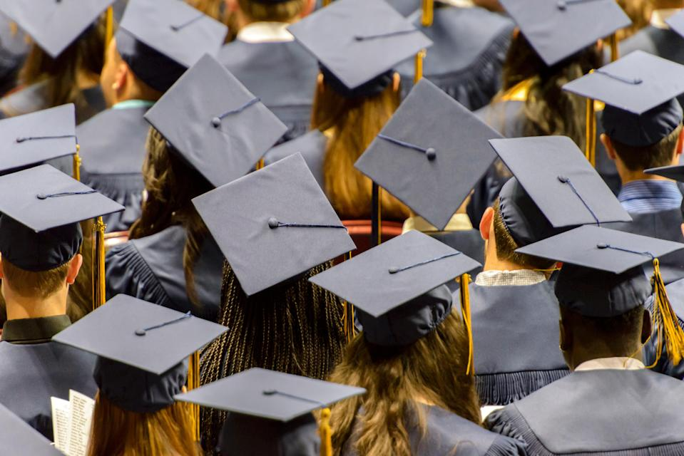 A group of graduating student wearing caps.
