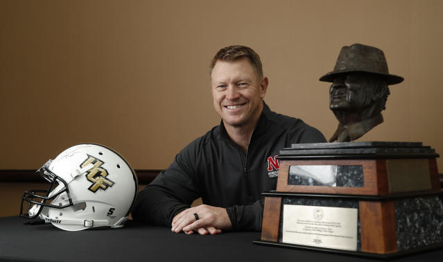 "Nebraska football coach Scott Frost, formerly with Central Florida, poses with the Paul ""Bear"" Bryant award ahead of the 32nd annual Paul ""Bear"" Bryant Awards, Wednesday, Jan. 10, 2018, in Houston. (Karen Warren/Houston Chronicle via AP)"