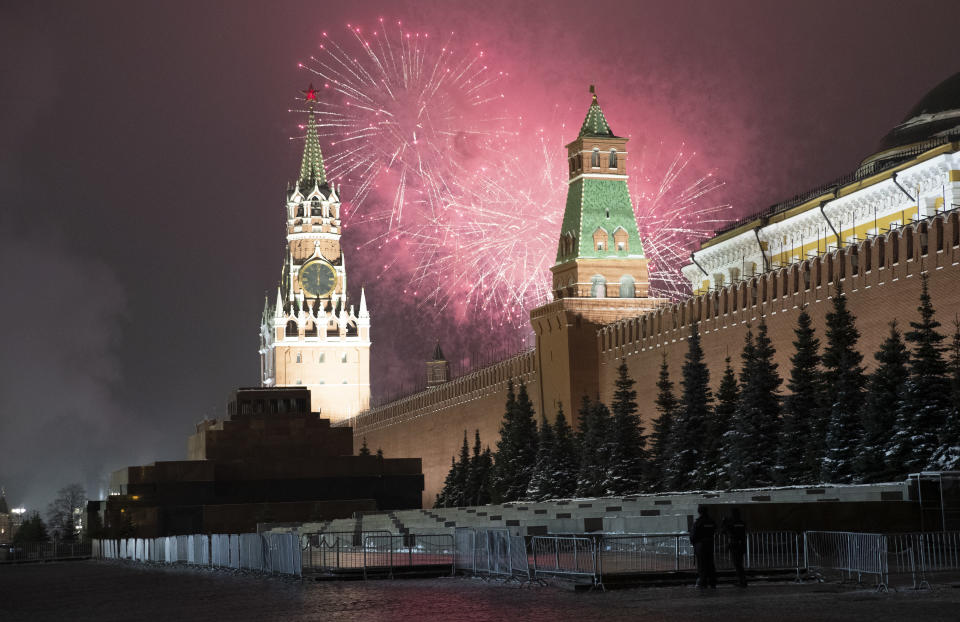 Fireworks explode over the Kremlin and almost empty Red Square during New Year's celebrations with the Spasskaya Tower during New Year celebrations, in Moscow, Russia, Thursday, Dec. 31, 2020. (AP Photo/Pavel Golovkin)