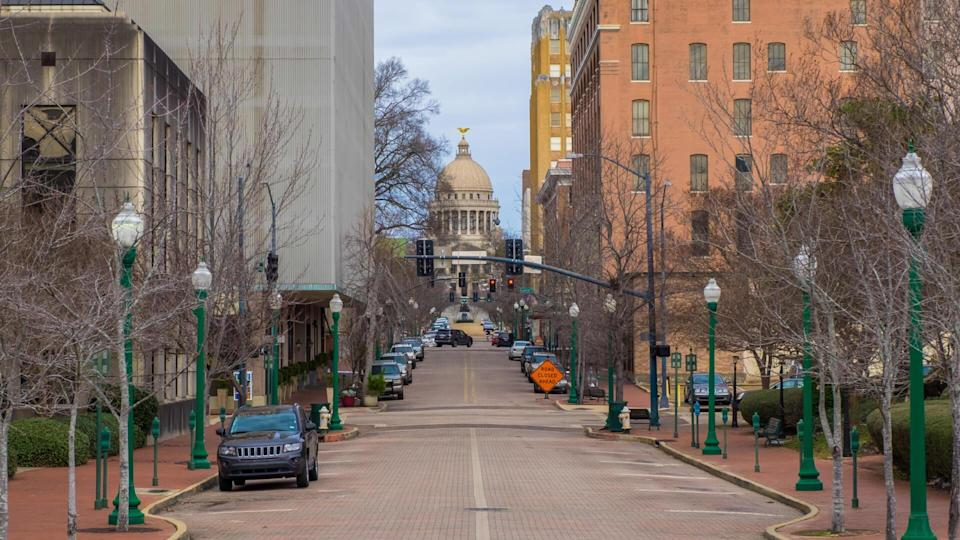 Downtown street in Jackson, Mississippi with the state capitol building.