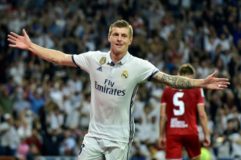 Real Madrid's midfielder Toni Kroos celebrates after scoring against Sevilla on May 14, 2017