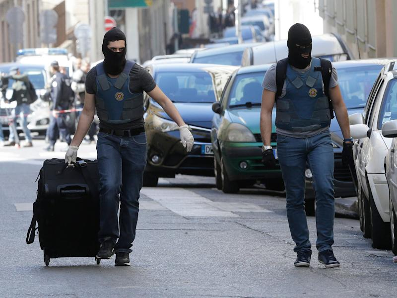 Masked elite police officers during searches in Marseille on 18 April: AP