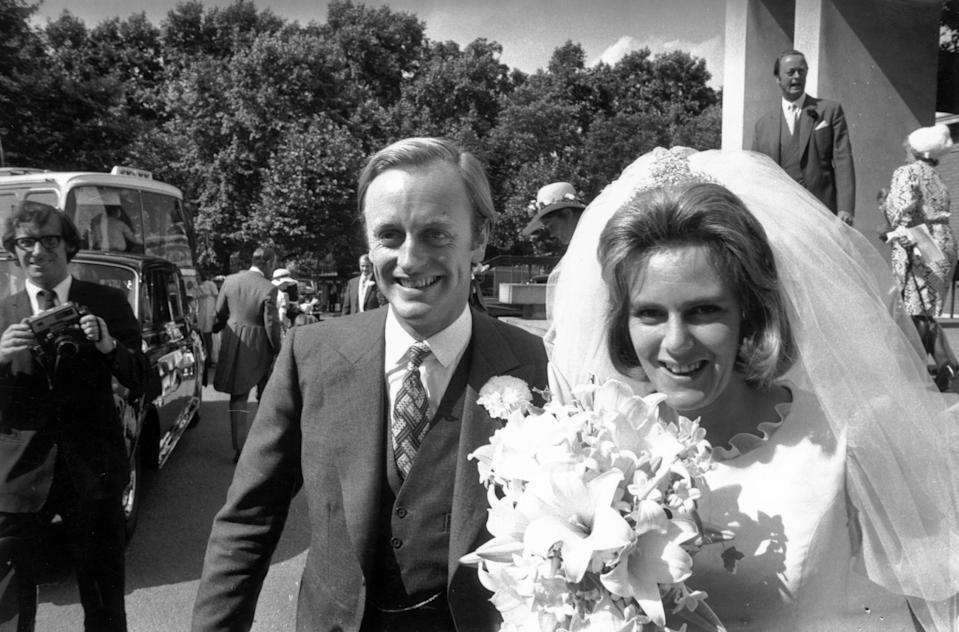 4th July 1973:  Camilla Shand and Captain Andrew Parker Bowles outside the Guards' Chapel on their wedding day.  (Photo by Frank Barratt/Keystone/Getty Images)