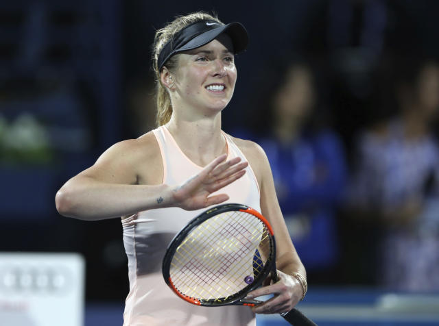 Elina Svitolina of Ukraine celebrates after she beats Angelique Kerber of Germany during a semi final match of the Dubai Duty Free Tennis Championship in Dubai, United Arab Emirates, Friday, Feb. 23, 2018. (AP Photo/Kamran Jebreili)