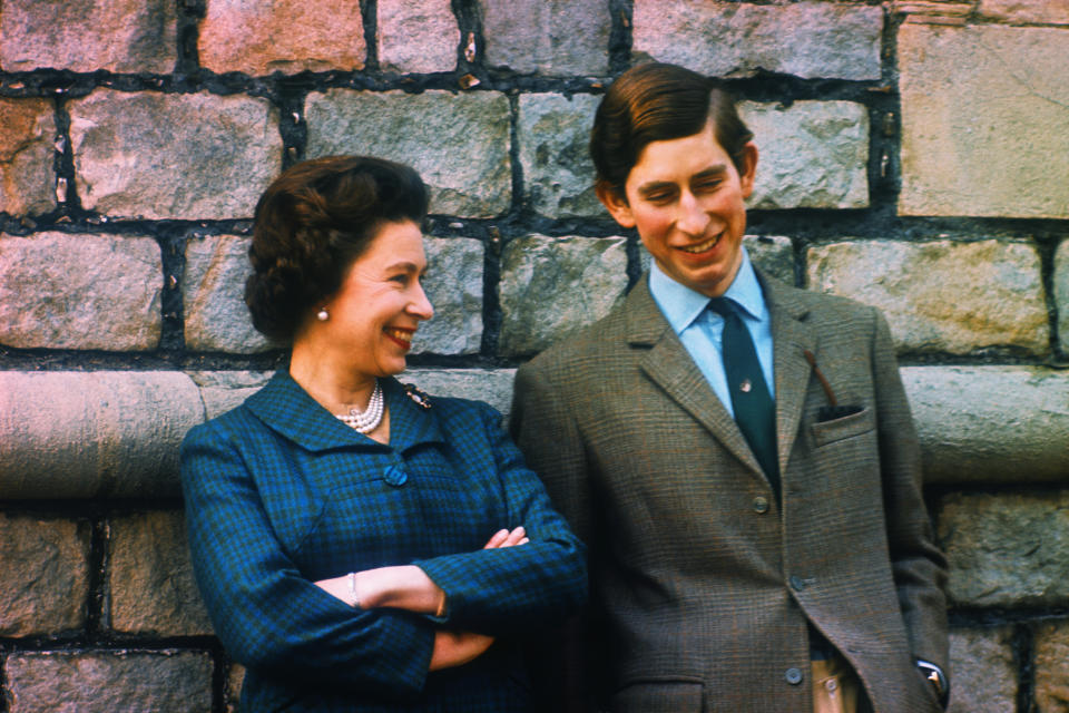 (Original Caption) Prince Charles and Queen Elizabeth are shown here at their Windsor home.