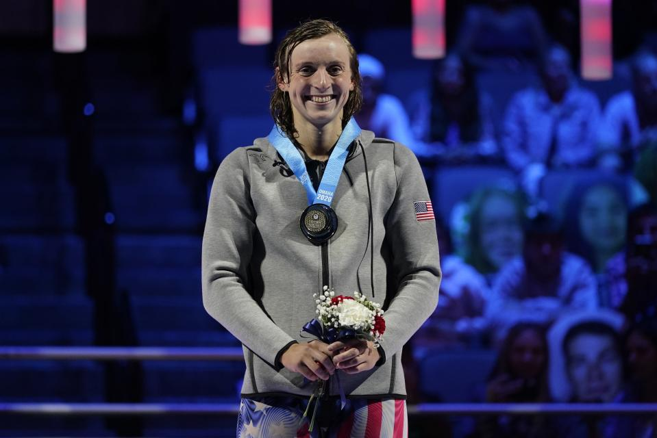 Katie Ledecky smiles at the medal ceremony after winning the women's 1500 freestyle during wave 2 of the U.S. Olympic Swim Trials on Wednesday, June 16, 2021, in Omaha, Neb.(AP Photo/Charlie Neibergall)