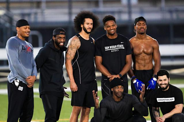 Colin Kaepernick stands with Bruce Ellington, Brice Butler, Jordan Veasy, and Ari Werts during the Kaepernick's NFL workout held at Charles R. Drew High School on November 16, 2019 in Riverdale, Georgia. (Photo by Carmen Mandato/Getty Images)