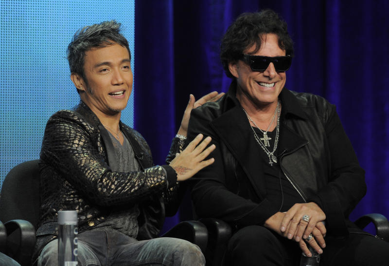 """Arnel Pineda, left, and Neal Schon of the rock band Journey take part in a panel discussion on the Independent Lens documentary """"Don't Stop Believin': Everyman's Journey,"""" at the PBS Summer 2013 TCA press tour at the Beverly Hilton Hotel on Tuesday, Aug. 6, 2013, in Beverly Hills, Calif. (Photo by Chris Pizzello/Invision/AP)"""