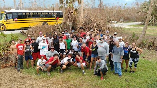 Members of the Key West football team helping the community clean up after Hurricane Irma. (Courtesy of Key West High School)
