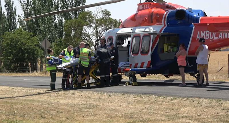 The rescue helicopter on the scene of the fatal crash. Source: Nine News
