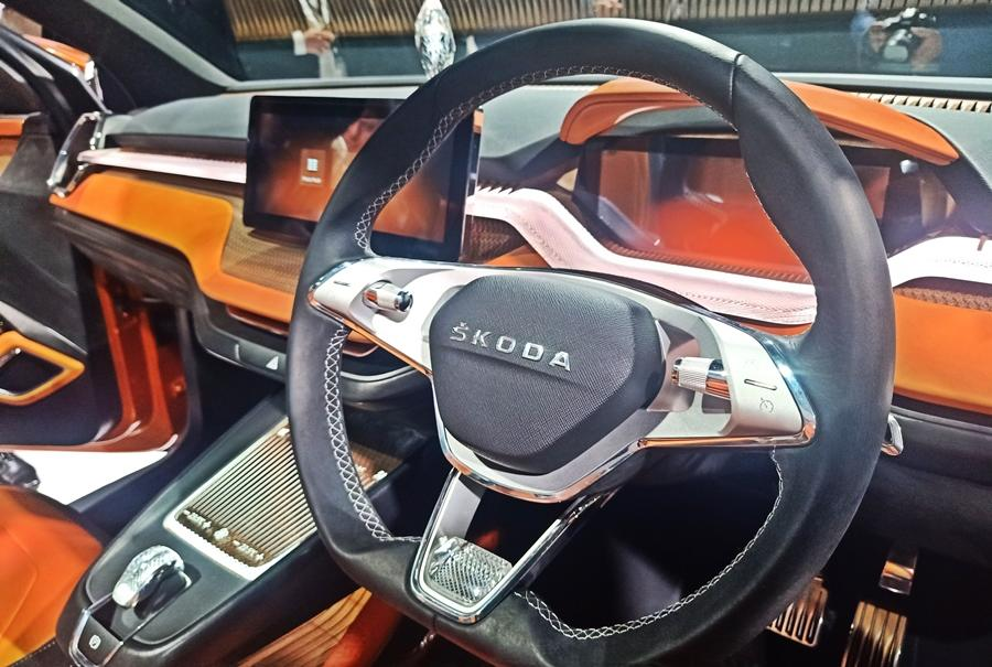 The interior is 'blingy' like a concept car, but the design is impressive. It consists a large touchscreen along with digital instruments. Coloured detailing also add a sporty touch.