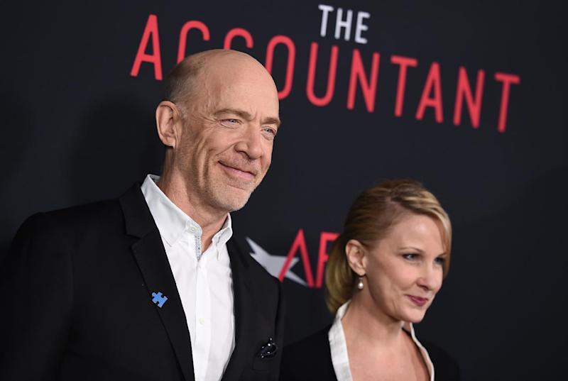 """J.K. Simmons, left, and Michelle Schumacher arrive at the world premiere of """"The Accountant"""" at the TCL Chinese Theatre on Monday, Oct. 10, 2016, in Los Angeles. (Photo by Jordan Strauss/Invision/AP)"""