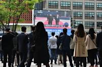 Seoul residents watch live footage of the meeting between South Korean President Moon Jae-in and North Korean leader Kim Jong Un at the Demilitarized Zone