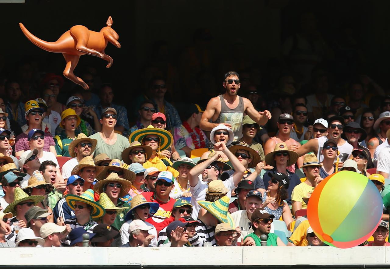 BRISBANE, AUSTRALIA - NOVEMBER 23:  The crowd show their support during day three of the First Ashes Test match between Australia and England at The Gabba on November 23, 2013 in Brisbane, Australia.  (Photo by Scott Barbour/Getty Images)