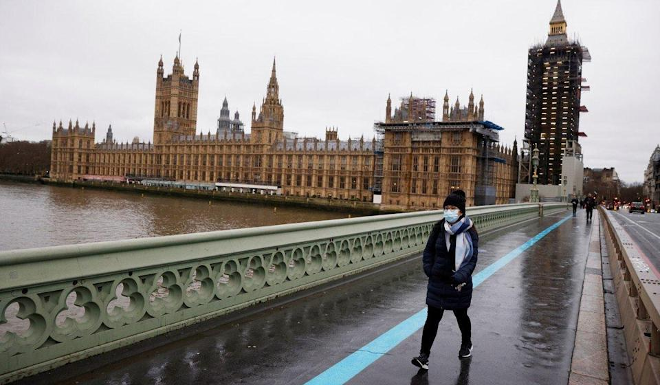 A woman walks across Westminster Bridge in London. Countries such as Britain, Australia and Canada have offered new immigration pathways for Hongkongers. Photo: Reuters