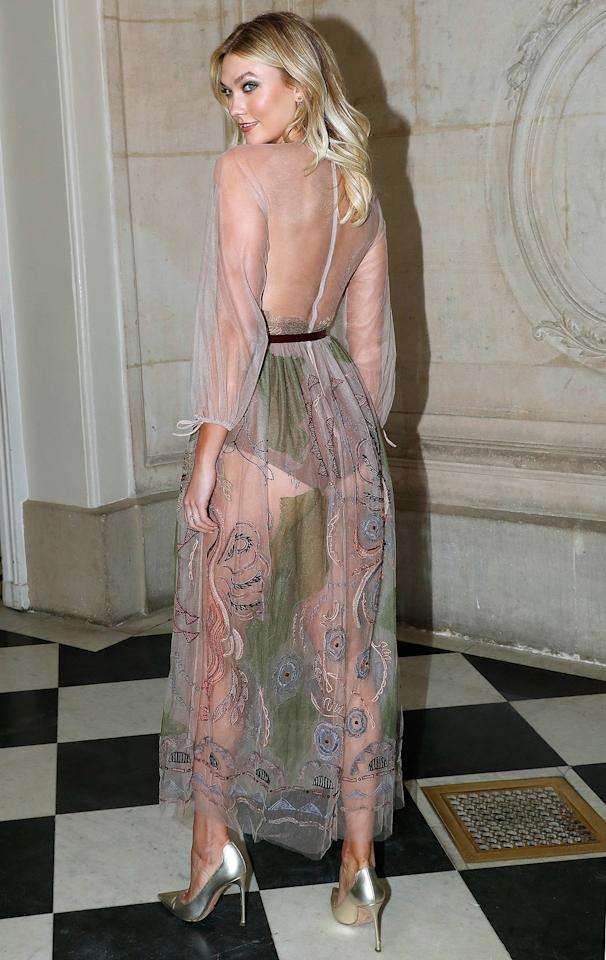 in a sheer embroidered Dior dress at the Christian Dior Spring 2019 Couture show in Paris.