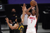 Houston Rockets guard Armoni Brooks, right, shoots as Los Angeles Lakers guard Talen Horton-Tucker defends during the second half of an NBA basketball game Wednesday, May 12, 2021, in Los Angeles. (AP Photo/Mark J. Terrill)