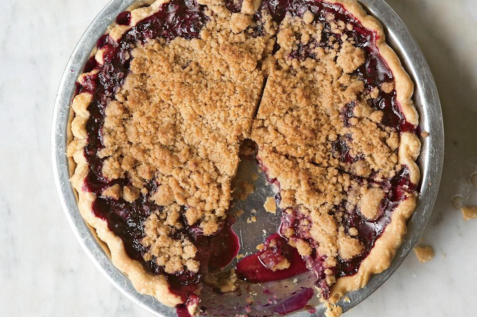 """The best blueberry pie combines the flaky crust of a fruit pie and the buttery topping of a crumble. You'll want to eat this all summer long. <a href=""""https://www.epicurious.com/recipes/food/views/blueberry-crumble-pie-366429?mbid=synd_yahoo_rss"""" rel=""""nofollow noopener"""" target=""""_blank"""" data-ylk=""""slk:See recipe."""" class=""""link rapid-noclick-resp"""">See recipe.</a>"""