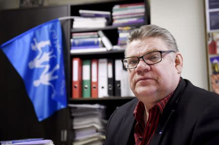 Chairman Soini of the Finns Party looks on during an interview in his study at the Finnish Parliament in Helsinki