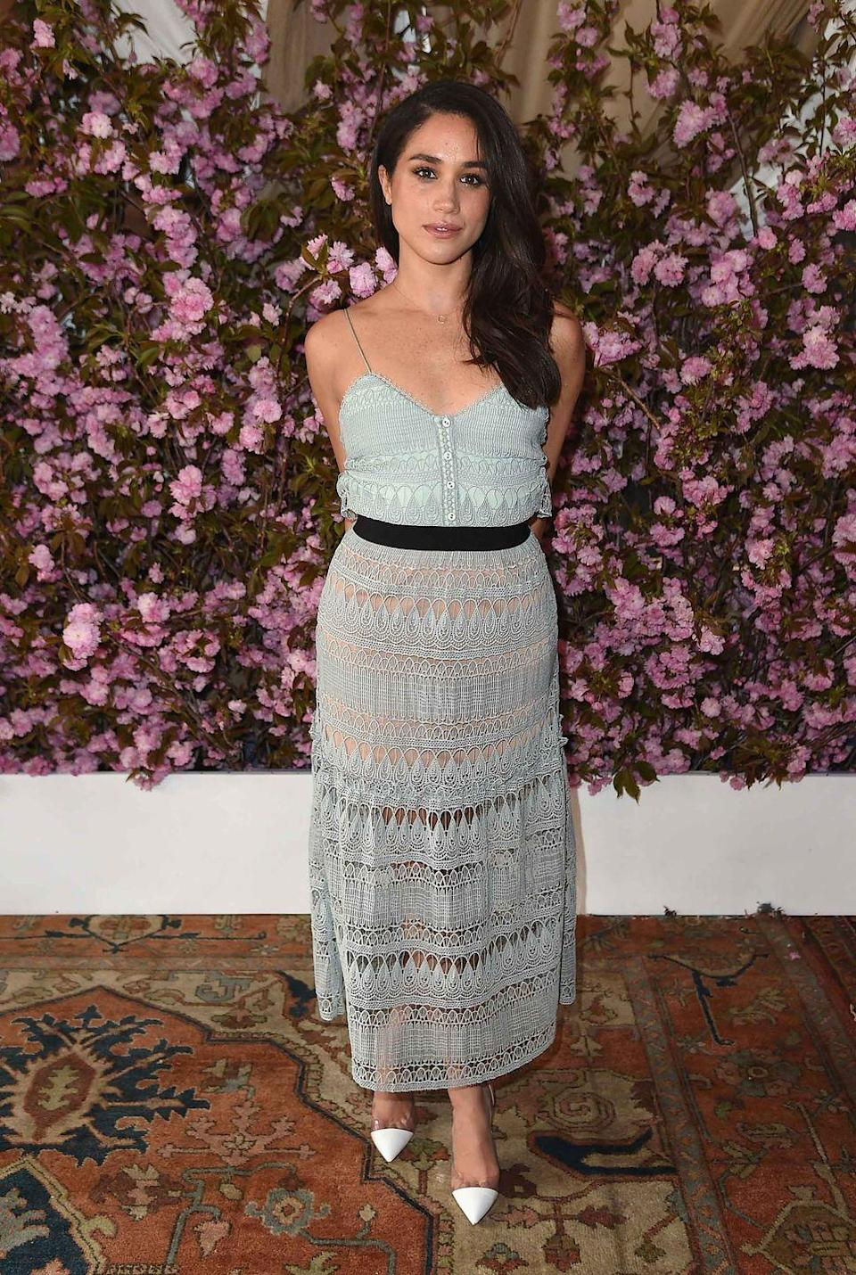 """<p>Markle attends the <em>Glamour</em> and L'Oreal Paris Celebrate 2016 College Women of the Year at NoMad Hotel Rooftop in New York City wearing a lace dress by Self-Portrait. </p><p><a class=""""link rapid-noclick-resp"""" href=""""https://go.redirectingat.com?id=74968X1596630&url=http%3A%2F%2Fwww.intermixonline.com%2Fself-portrait%2Fbandeau-chevron-knit-maxi-dress%2FSP17-072L.html&sref=https%3A%2F%2Fwww.townandcountrymag.com%2Fstyle%2Ffashion-trends%2Fg3272%2Fmeghan-markle-preppy-style%2F"""" rel=""""nofollow noopener"""" target=""""_blank"""" data-ylk=""""slk:SHOP SIMILAR"""">SHOP SIMILAR</a> <em>Self-Portrait Bandeau Chevron Knit Maxi Dress, $580 </em><br></p>"""
