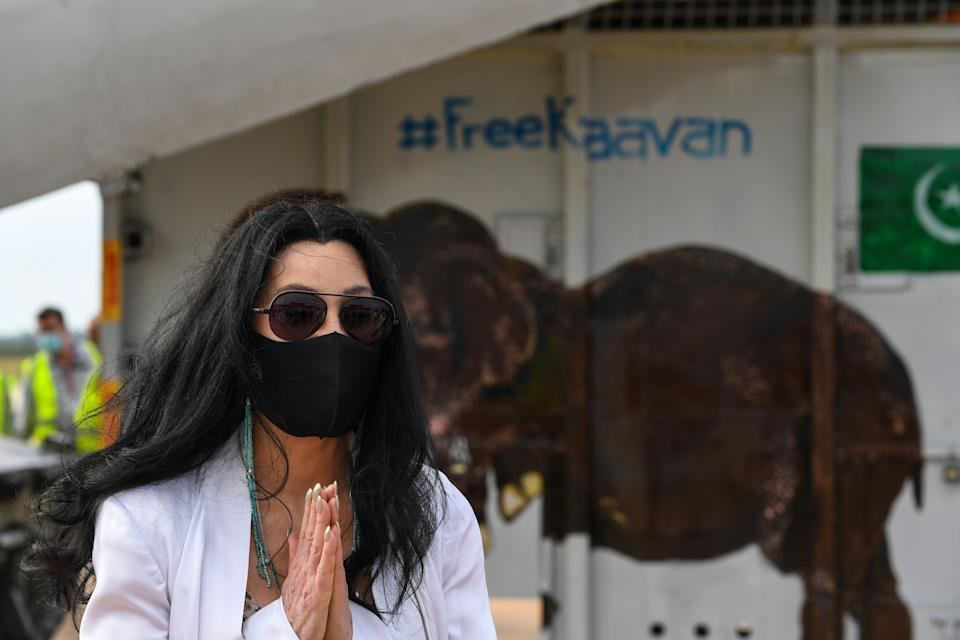 US pop singer Cher gestures in front of the crate of Kaavan the Asian elephant upon his arrival in Cambodia from Pakistan at Siem Reap International Airport in Siem Reap on November 30, 2020. (Photo by TANG CHHIN Sothy / AFP) (Photo by TANG CHHIN SOTHY/AFP via Getty Images)