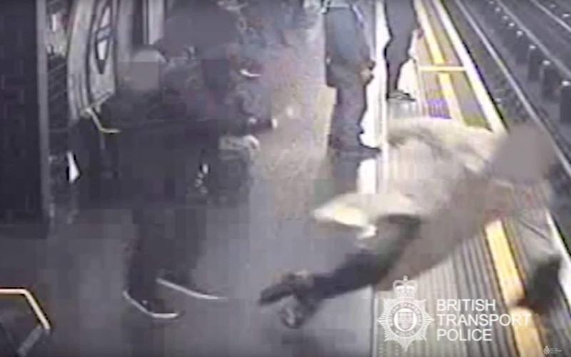 CCTV issued by British Transport Police of Sir Robert Malpas being pushed on to the tracks by Paul Crossley - PA