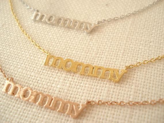 "<p>These <a href=""https://www.popsugar.com/buy/Tiny-Mommy-Necklaces-415677?p_name=Tiny%20%22Mommy%22%20Necklaces&retailer=etsy.com&pid=415677&price=18&evar1=moms%3Aus&evar9=45844588&evar98=https%3A%2F%2Fwww.popsugar.com%2Ffamily%2Fphoto-gallery%2F45844588%2Fimage%2F45844629%2FTiny-Mommy-Necklace&prop13=api&pdata=1"" class=""link rapid-noclick-resp"" rel=""nofollow noopener"" target=""_blank"" data-ylk=""slk:Tiny &quot;Mommy&quot; Necklaces"">Tiny ""Mommy"" Necklaces</a> ($18) are available in silver, gold, or rose gold.</p>"