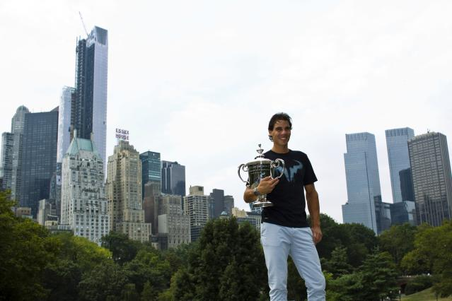 Rafael Nadal of Spain poses with his trophy after winning the men's singles final match against Novak Djokovic of Serbia at the U.S. Open tennis tournament in New York's Central Park, September 10, 2013. REUTERS/Eduardo Munoz (UNITED STATES - Tags: SPORT TENNIS)