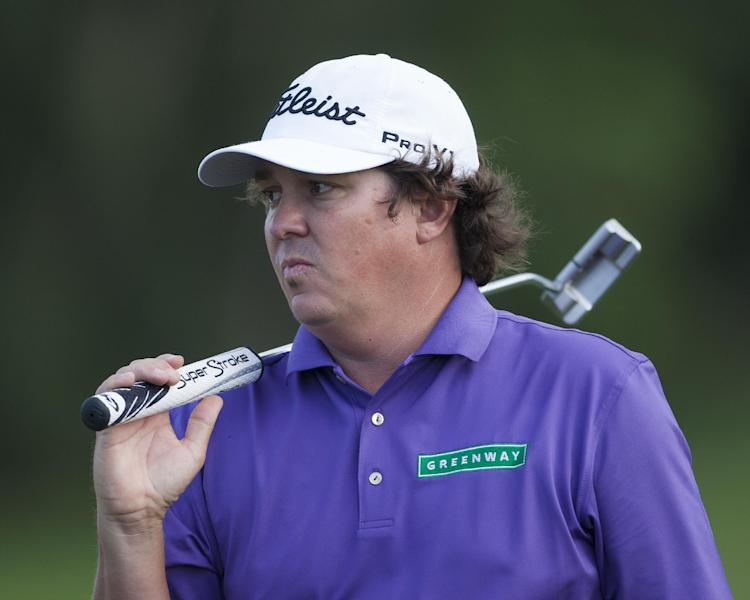 Jason Dufner walks off the 17th green after making par on the hole during the first round of the Tournament of Champions golf tournament on Friday, Jan. 3, 2014, in Kapalua, Hawaii. (AP Photo/Marco Garcia)