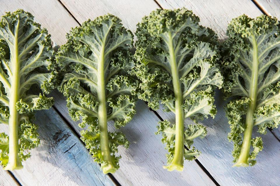 "<p>""Kale is a cruciferous vegetable that's brimming with vitamins, minerals and antioxidants,"" says Dr. Axe. ""It's also a great source of fiber, with 2 grams in each cup. Fiber moves slowly through the intestinal tract undigested, keeping you feeling fuller for longer while also promoting regularity and digestive health.""</p>"