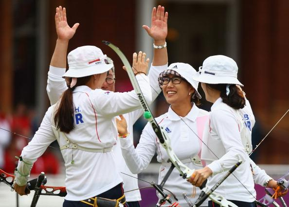 LONDON, ENGLAND - JULY 29:  Hyeonju Choi, Bobae Ki and Sung Jin Lee of Korea celebrate victory in the Women's Team Archery Gold medal match between Korea and China on Day 2 of the London 2012 Olympic Games at Lord's Cricket Ground on July 29, 2012 in London, England.  (Photo by Paul Gilham/Getty Images)