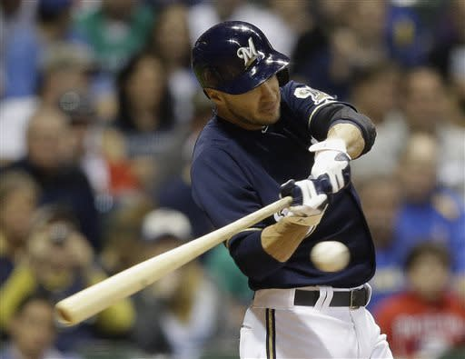 Milwaukee Brewers' Ryan Braun hits a triple during the sixth inning of a baseball game against the Texas Rangers, Wednesday, May 8, 2013, in Milwaukee. (AP Photo/Morry Gash)
