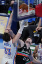 Oklahoma City Thunder center Mike Muscala (33) dunks over San Antonio Spurs forward Drew Eubanks (14) during the second half of an NBA basketball game Wednesday, Feb. 24, 2021, in Oklahoma City. (AP Photo/Sue Ogrocki)