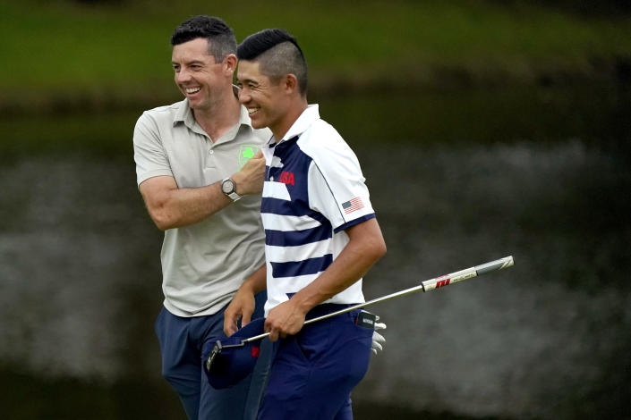 Rory McIlroy, of Ireland, left, and Collin Morikawa, of the United States, laugh after the first round of the men's golf event at the 2020 Summer Olympics, Thursday, July 29, 2021, at the Kasumigaseki Country Club in Kawagoe, Japan, (AP Photo/Matt York)