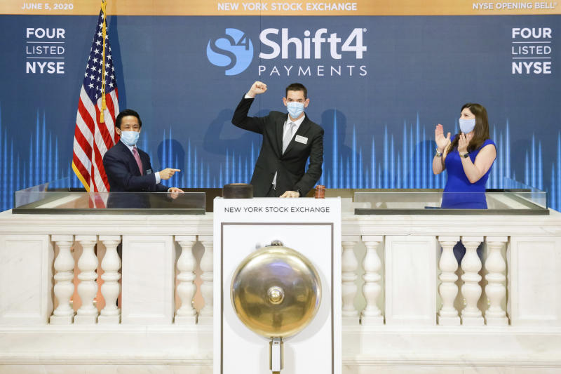IMAGE DISTRIBUTED FOR THE NEW YORK STOCK EXCHANGE - Shift4 Payments, Inc. (NYSE: FOUR) rings The Opening Bell on Friday, June 5, 2020, in New York. The New York Stock Exchange welcomes Shift4 Payments, Inc. (NYSE: FOUR) in celebration of its IPO. To honor the occasion, Jared Isaacman, Chief Executive Officer, Christopher Cruz, Managing Director, Searchlight Capital, and Stacey Cunningham, NYSE President, ring the NYSE Opening Bell. (New York Stock Exchange via AP Images)