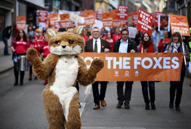 "Protesters during a march on the Royal Mile in Edinburgh organised by the League Against Cruel Sports, OneKind and IFAW calling for a ""real"" fox hunting ban."